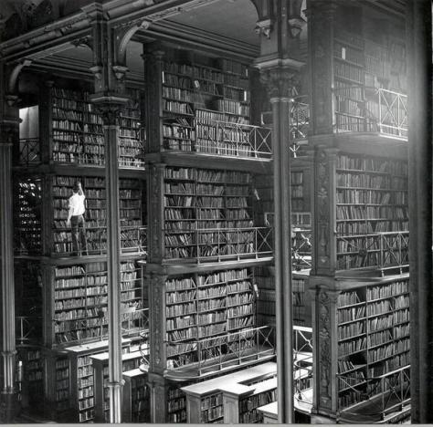 A man browsing for books in Cincinnati's cavernous old main library. The library was demolished in 1955. History in Pictures.