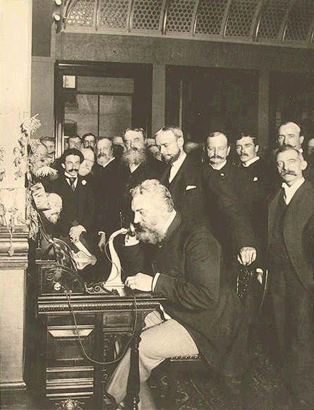 Alexander Graham Bell on the telephone in New York (calling Chicago), 1892. Classic Pics.
