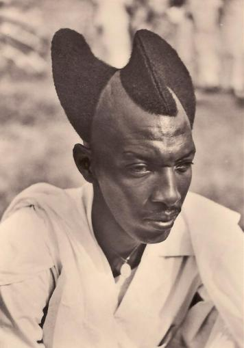 Rwandan man with Amasunzu hairstyle, 1923. History in Pictures.