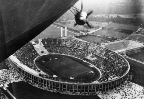 The Hindenburg flying over the 1936 Olympics. Historical Pics.