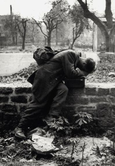 A German soldier finally arrives home, only to find his family gone. Photograph by Tony Vaccaro, 1946. History in Pictures.