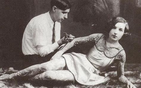 A woman by the name of Stella Grassman being tattooed in the early 1900s. History in Pictures.