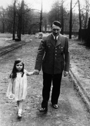 Adolf Hitler on a walk with Helga Goebbels, 1936. Helga was later killed with cyanide by her parents. History in Pictures.