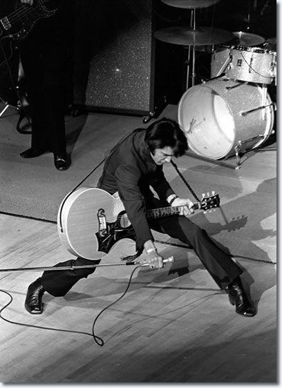 Elvis Presley on stage in Las Vegas, 1969. History in Pictures.