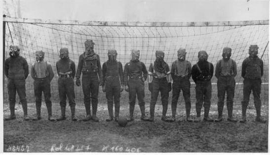 Football team of British soldiers with gas masks, World War I, somewhere in Northern France, 1916. Historical Pics.