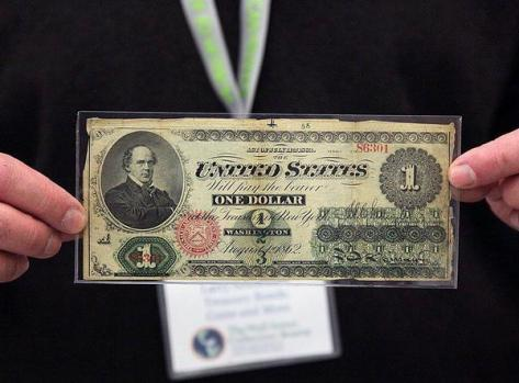 This is a One Dollar Bill from 1862. Historical Pics.
