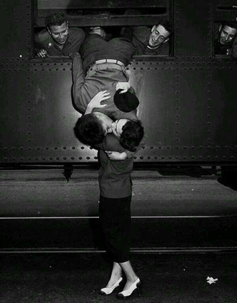 A goodbye kiss in 1950 between a soldier and his love. Classic Pics.