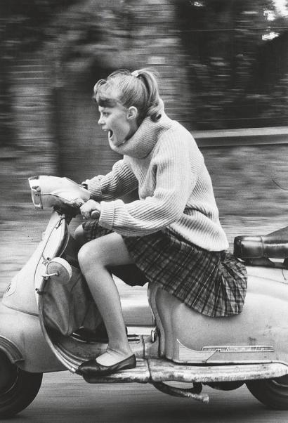 French girl speeding on a scooter, 1984. Classic Pics.