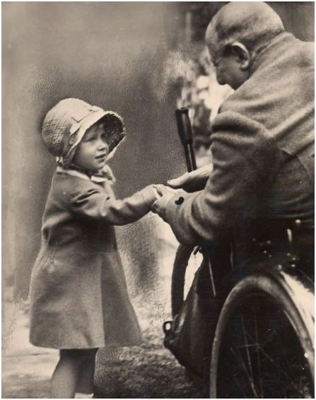 Queen (then Princess) Elizabeth II shakes hands with an old soldier in London, circa 1929. History in Pictures.