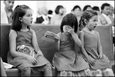 The reaction of little girls when they see a wedding kiss. Historical Pics.