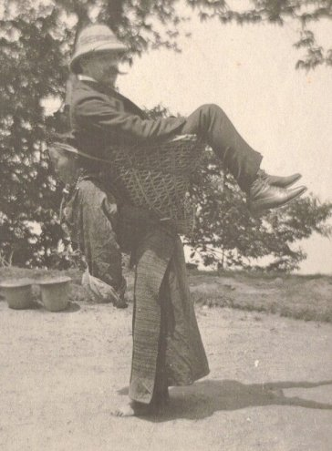 A Sikkimese woman carrying a British man on her back, West Bengal, India, circa 1900. Historical Pics.