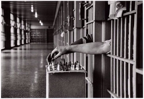 Inmates playing chess from their cells at Attica Correction Facility, New York, 1972.  Photograph by Cornell Capa. Classic Pics.