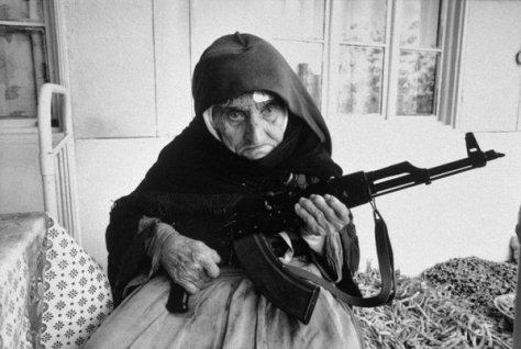A 106-year-old Armenian woman guards her home with a rifle, in Degh village, 1990. History in Pictures.