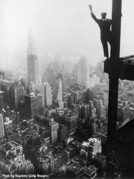 A steel worker balances on a girder during the construction of the Empire State Building in New York City, 1931. Historical Pics.