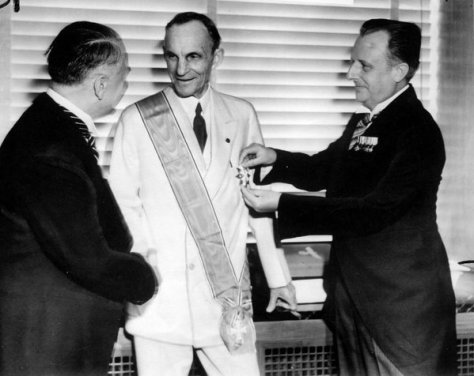 Henry Ford receiving the Grand Cross of the German Eagle from Nazi officials, 1938. History in Pictures.