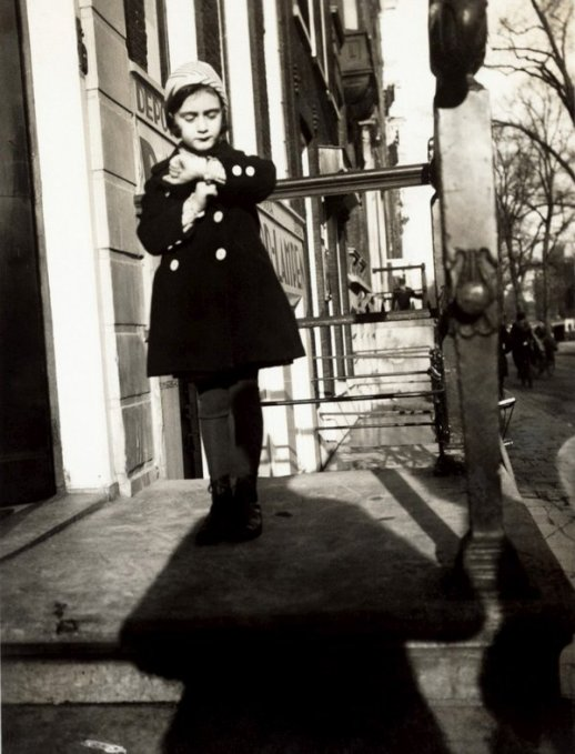 A five year old Anne Frank stands on the steps of her father's office. Amsterdam, 1934. Classic Pics.