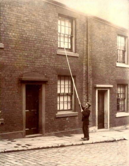 Before alarm clocks were affordable, 'knocker-ups' were used to wake people early in the morning. UK, c1900 . Historical Pi9cs.