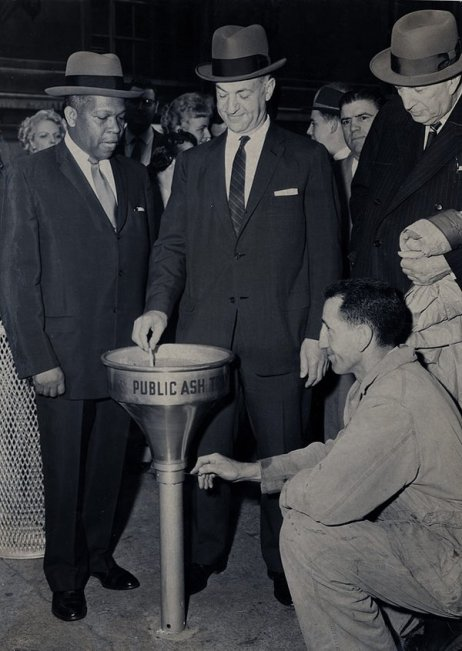 Government officials celebrate the installation of the first public ashtray on NYC streets, 1958. History in Pictures.