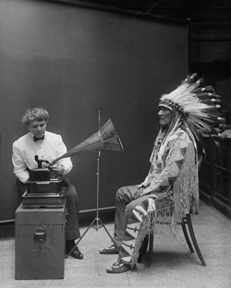 Mountain Chief, a Blackfoot Chief, making a phonographic record at the Smithsonian. Photograph by Harris & Ewing.  History in Pictures.