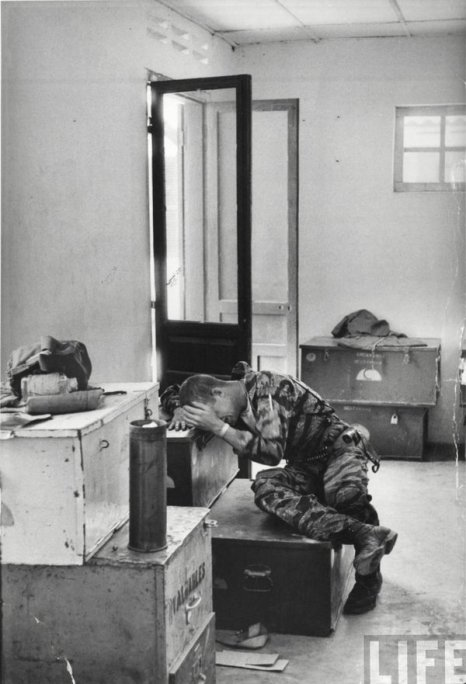 Chopper pilot post-mission, Vietnam 1965. Photograph by Larry Burrows. History in Pictures.
