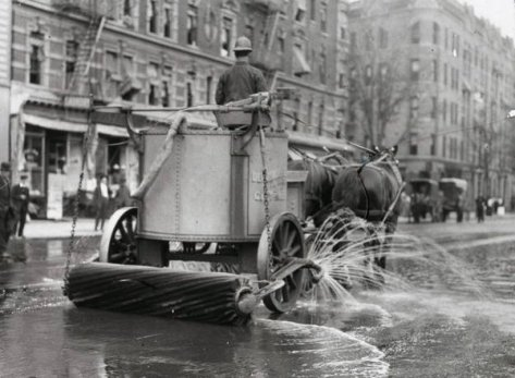 A two horse team street cleaner, with sprayer, squeegee, and roller at rear. Old Pics Archive.