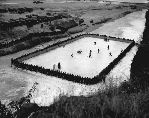 Canadian soldiers serving in Korea made a hockey rink, 1952. Old Pics Archive.