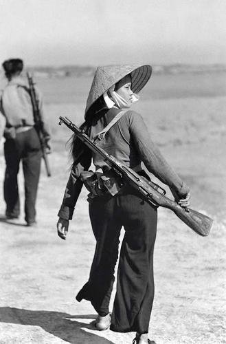 Viet Cong female soldier. Old Pics Archive.