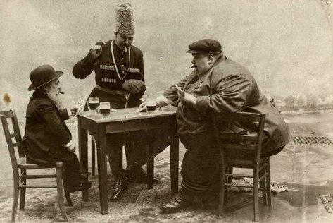 A French postcard with the tallest, shortest, and fattest men of Europe playing a game of cards, circa 1913. Classic Pics.