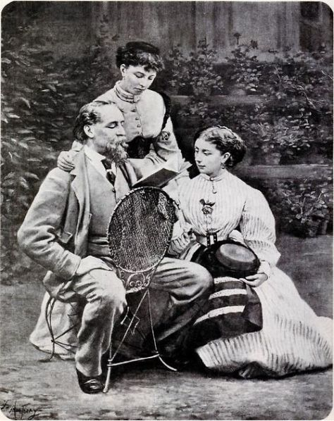 Charles Dickens reading to his two daughters. Old Pics Archive.