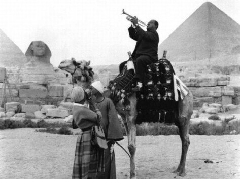 Louis Armstrong once played his trumpet while riding a camel in Egypt. Old Pics Archive.