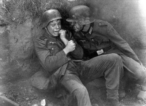 Terrified German soldier... he's just a kid... this breaks my heart. History in Pictures.