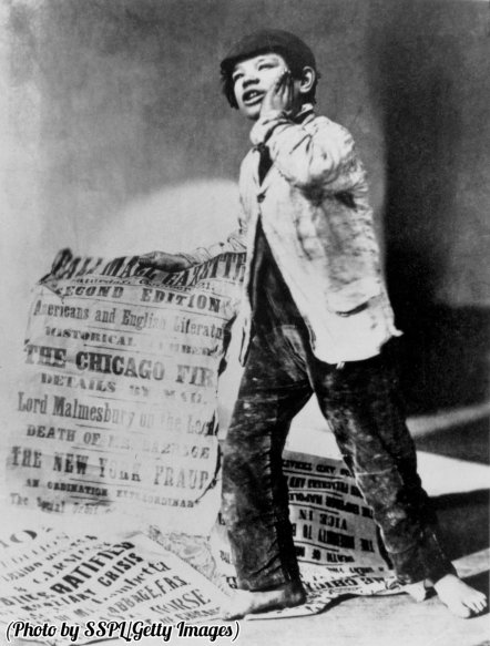 a-london-newspaper-boy-holding-a-placard-with-headlines-of-the-day-including-one-for-the-great-chicago-fire-1871-history-in-pictures