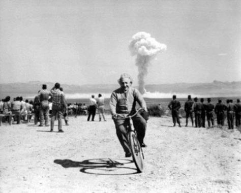 Einstein riding a bicycle down range from a nuclear bomb test. History in Pictures.