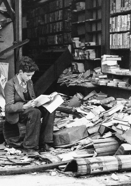 a-boy-sits-amid-the-ruins-of-a-london-bookshop-after-an-air-raid-oct8-1940-reading-a-book-the-history-of-london-history-in-pictures