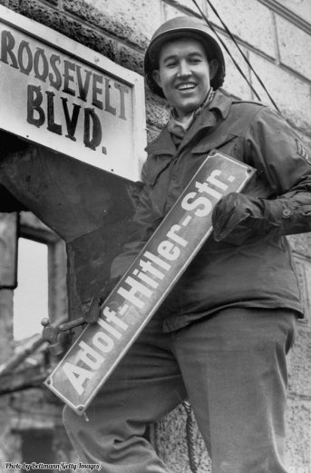 sergeant-george-a-kaufman-changes-a-street-sign-from-adolf-hitler-strasse-to-roosevelt-boulevard-in-krefeld-germany-1945-history-in-pictures