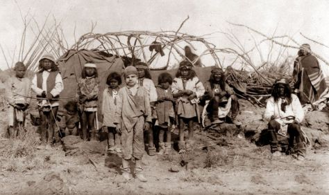 the-captive-white-boy-santiago-mckinn-poses-with-children-in-geronimos-camp-old-pics-archive