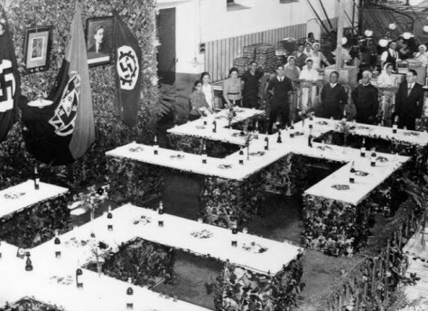 German visit to a cannery in Setúbal (Swastika table arrangement detail) -1938