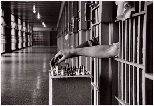 Inmates playing chess from their cells at Attica Correction Facility, New York, 1972. Photograph by Cornell Capa. History in Pictures.