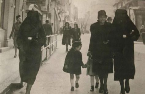 A Muslim woman covers the yellow star of her Jewish neighbour with her veil to protect her, Sarajevo, 1941. History in Pictures.