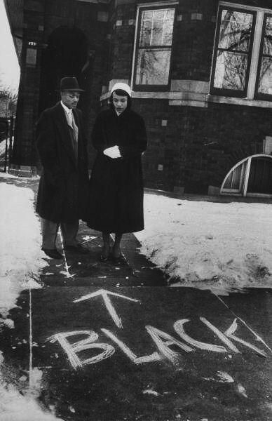 Chicago, 1957.. a couple who moved into an all-white neighborhood looking at graffiti in front of their home. History in Pictures.
