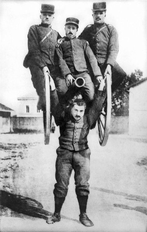 A strongman in the French army lifting a cannon overhead along with three of his comrades astride it, (1917). Historical Pics.