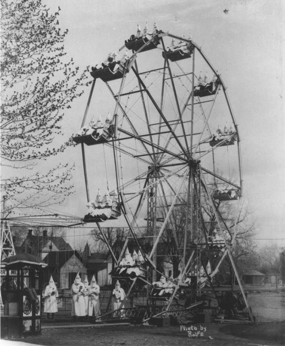 Ku Klux Klan on a ferris wheel, 1925. Mood Vintage.