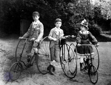 Children with their tricycles, Latvia, 1900. Old Pics Archive.