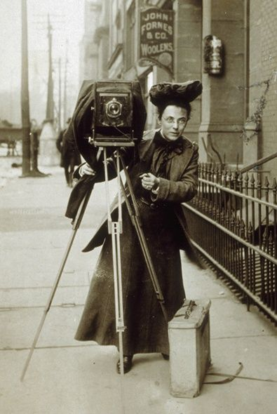 Female photojournalist Jessie Tarbox on the street with her camera, 1900s. Old Pics Archive.
