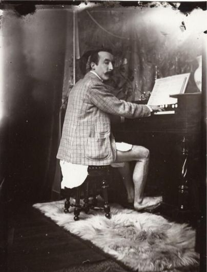 Paul Gauguin playing the harmonium with no trousers on, 1895. Mood Vintage.