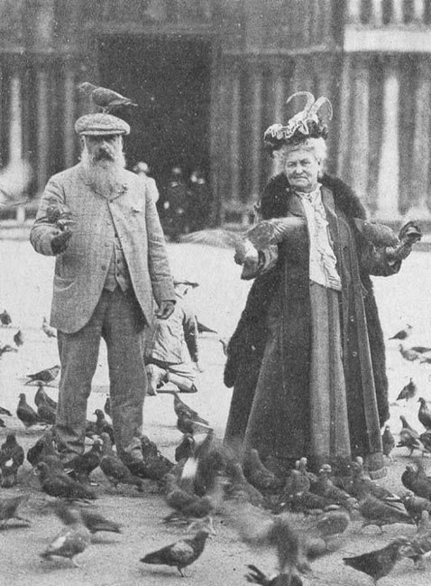 Claude Monet and his wife in St. Mark's Square, Venice, Italy in 1908. Old Pics Archive.